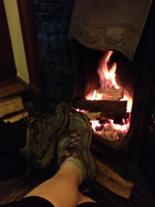 Warming our tootsies beside a log fire at Lower Buck Inn, Waddington
