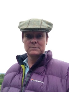 Trying out Bri's flat cap during a downpour.  What d'ya think?