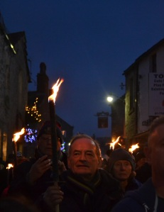Visitors can purchase torches and join the procession through the cobbled village streets