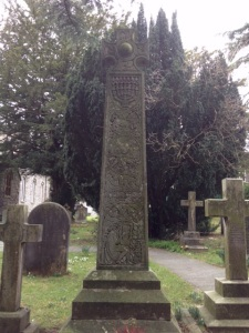 Poet John Ruskin's grave at Coniston.  Marked with a large cross made from green slate from the local quarry at Tilberthwaite