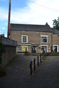 The village store viewed from the alleyway that leads to the pub - all used in the BBC drama 'The Village'
