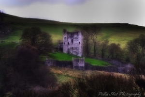 The imposing Peveril Castle standing above the village