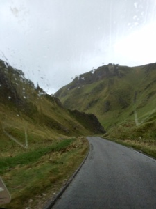 Driving through the towering limestone pinnacles of Winnats Pass