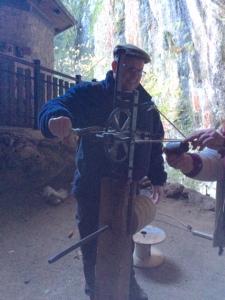 Bri trying his hand at rope making. The hemp stinks!