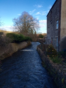 The stream that runs the village was swollen following the recent rainfall
