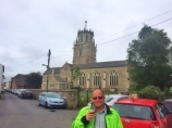 Bri outside St Andrew's Church with its bell ringing
