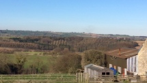 Woods in the distance viewed from Queen's Head at Finghall, said to have inspired Kenneth Grahame's 'Wind in the Willows'