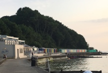 The Hut and row of beach huts